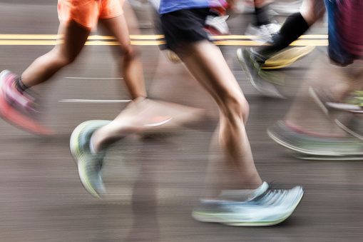 Blurred Action Of Marathon Runners On City Street