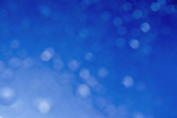 blurred and bokeh refection lighting of droplet on blue screen background. - green screen background stock photos and pictures