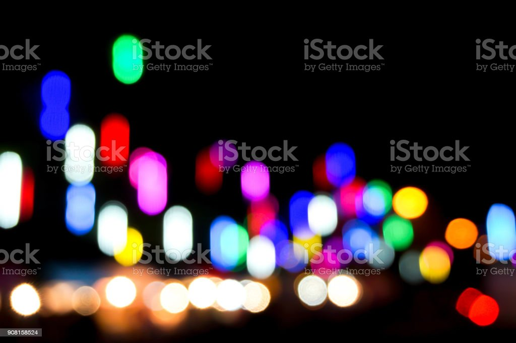 Blurred and bokeh reflection colorful lighting of city and night life stock photo