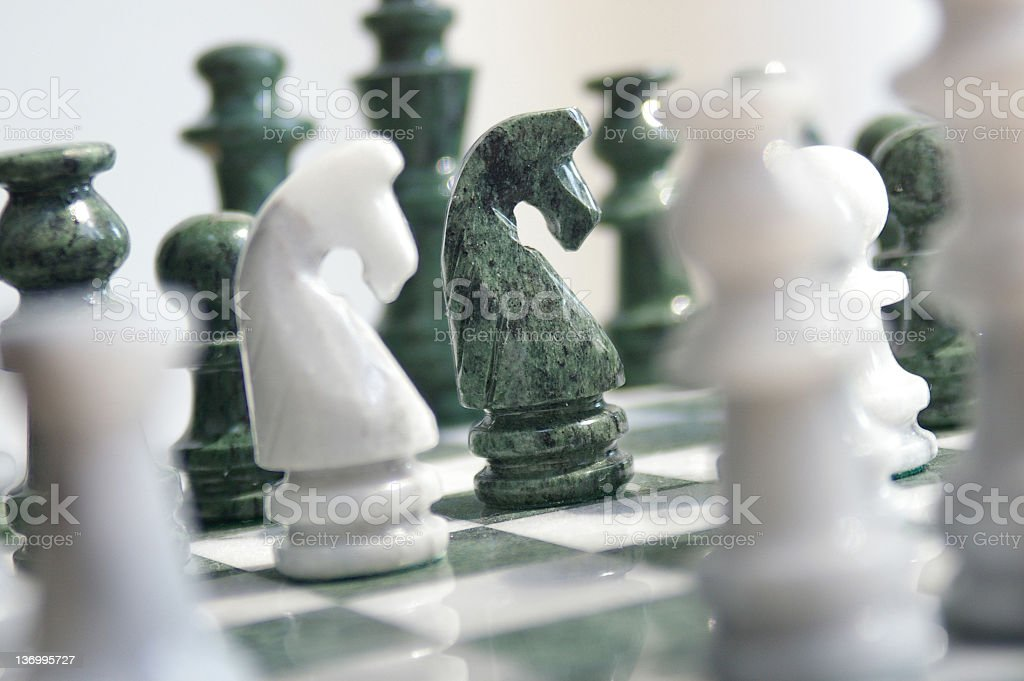 Blurred and clear black and white chess pieces stock photo