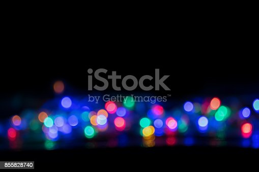 617566268 istock photo Blurred and defocused christmas colorful lights abstract background 855828740