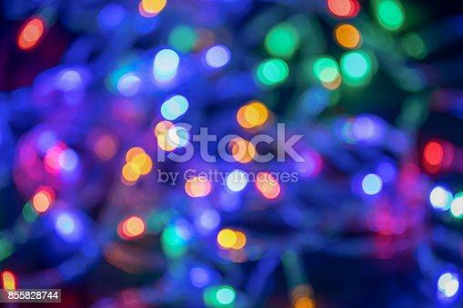 istock Blurred and defocused christmas colorful lights abstract background 855828744