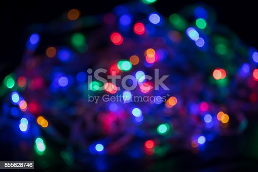 istock Blurred and defocused christmas colorful lights abstract background 855828746