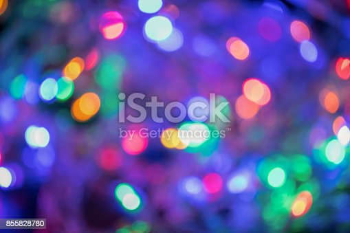 istock Blurred and defocused christmas colorful lights abstract background 855828780