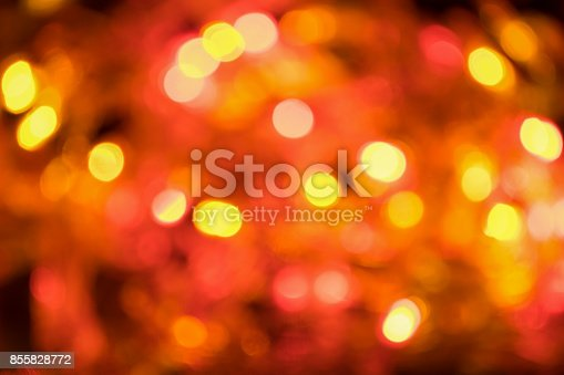 istock Blurred and defocused christmas red, orange and yellow lights abstract background 855828772