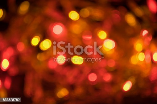 istock Blurred and defocused christmas red, orange and yellow lights abstract background 855828782