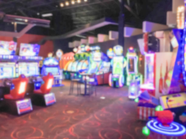 Blurred arcade game room at entertainment complex in America stock photo