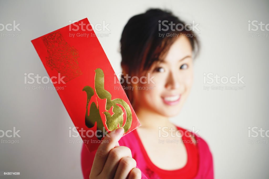 Blurred Asian girl show red Envelopes in her hands stock photo