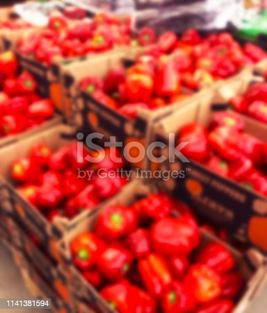 823709528 istock photo Blurred bacground with Fresh pods of red peppers i supermarket store. Close up. Blur bokeh lights. Abstract blurred supermarket store. Interior shopping mall defocused background 1141381594
