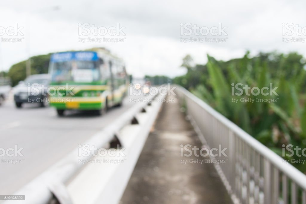 blurred backgroud of public bus and car crossing bridge road higway in thailand stock photo
