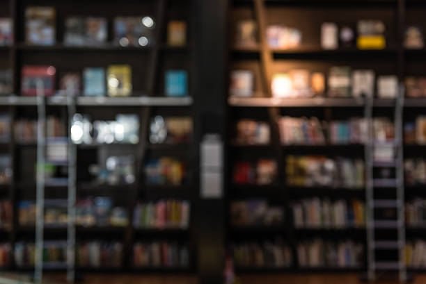 blurred backgroun of bookshelf in a library stock photo