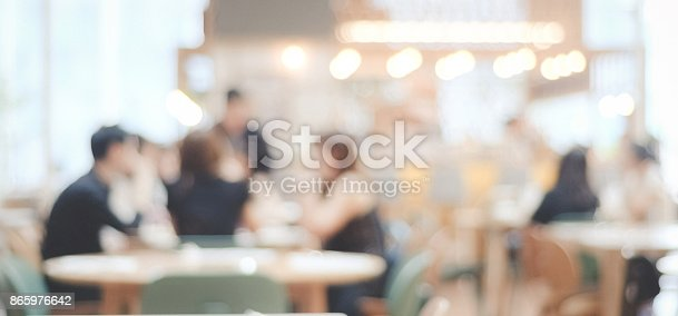 istock Blurred background : blur restaurant with people on bokeh light background, banner 865976642