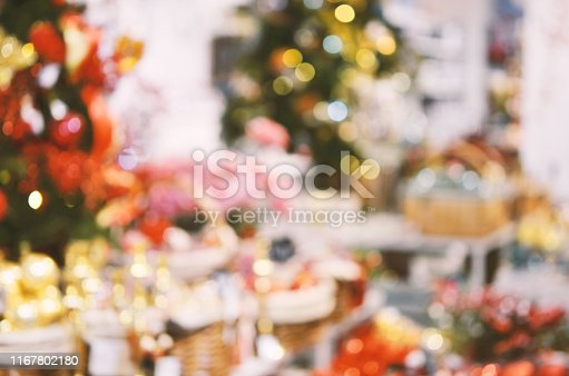 istock Blurred background. Bright Christmas decoration in shopping center 1167802180