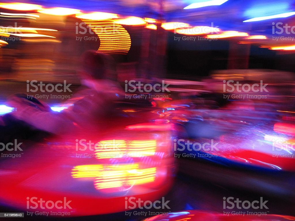 blurred background bright lights colors dodgem bumper cars intoxication stock photo