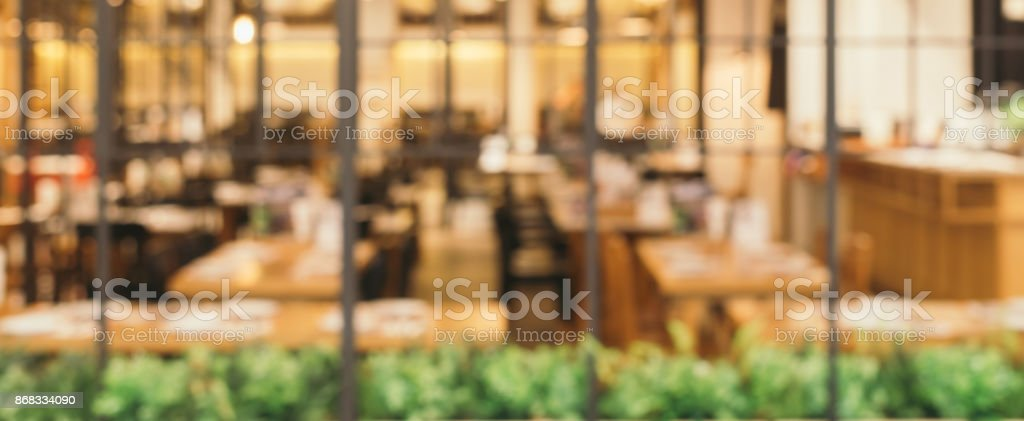 Blurred background - Coffee shop in building blur background with bokeh. Vintage filtered image. Panoramic banner background. stock photo