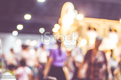 istock Blurred background : crowd of people in expo fair 511542582