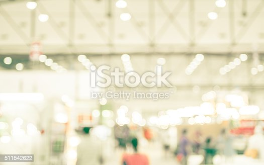 istock Blurred background : crowd of people in expo fair 511542622
