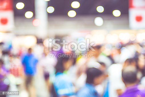istock Blurred background : crowd of people in expo fair 511542722