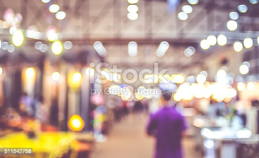 istock Blurred background : crowd of people in expo fair 511542758