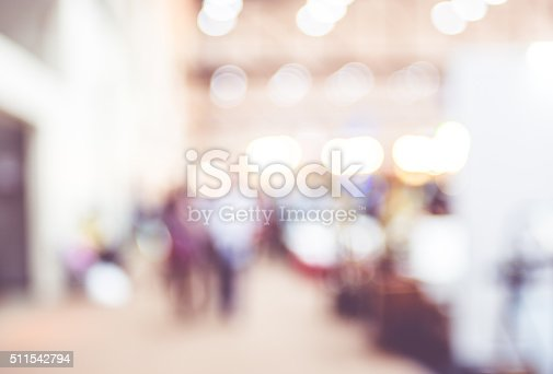istock Blurred background : crowd of people in expo fair 511542794