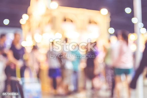 Blurred background: crowd of people in expo fair with bokeh light ,Vintage filter