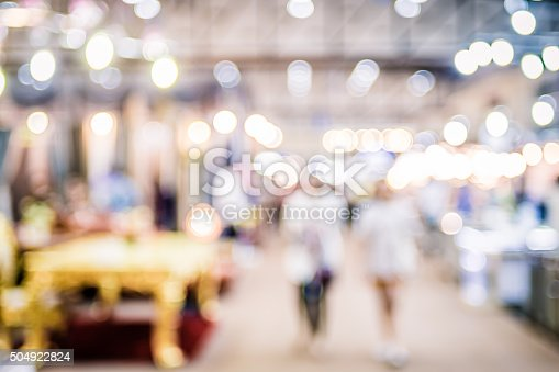 istock Blurred background: crowd of people in expo fair with bokeh 504922824