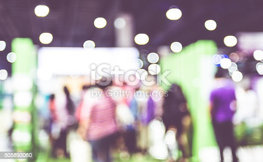 istock Blurred background: crowd of people in expo fair with bokeh 505893080