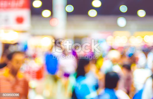 istock Blurred background: crowd of people in expo fair with bokeh 505893096