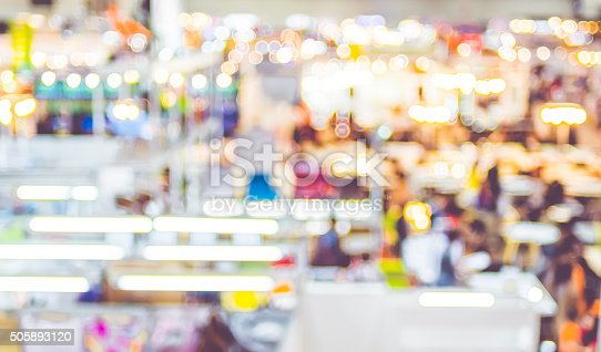 istock Blurred background: crowd of people in expo fair with bokeh 505893120