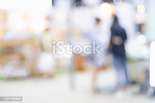istock Blurred background crowd of people shopping in event expo trade fair with bokeh light. 1034183830