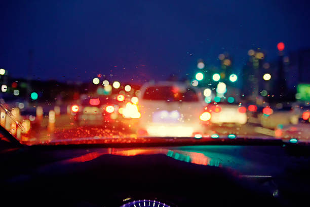 Blurred background : Inside car with bokeh lights from traffic jam on night time for background. stock photo