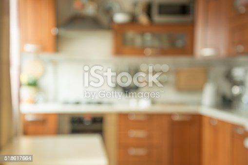 834157738 istock photo Blurred background. Modern kitchen with bokeh light. 518617664