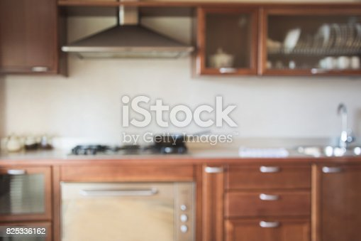 834157738istockphoto Blurred background. Modern kitchen with bokeh light. 825336162