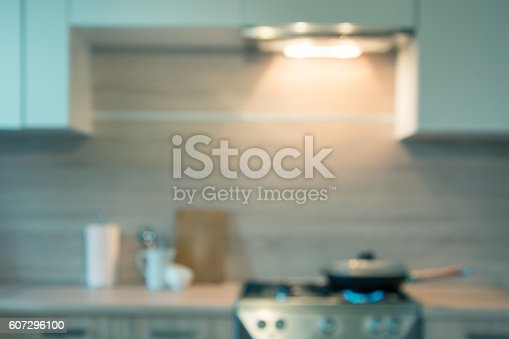 607472174 istock photo Blurred background. Modern kitchen with cooking on gas. Toned image. 607296100