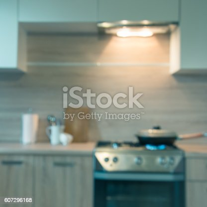 607472174 istock photo Blurred background. Modern kitchen with cooking on gas. Toned image. 607296168