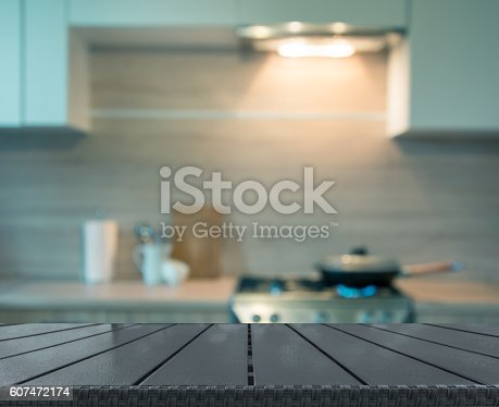 607472174 istock photo Blurred background. Modern kitchen with cooking on gas. Toned image. 607472174