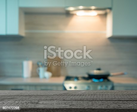 istock Blurred background. Modern kitchen with cooking on gas. Toned image. 607472268