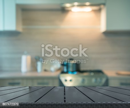 607472174istockphoto Blurred background. Modern kitchen with cooking on gas. Toned image. 607472370