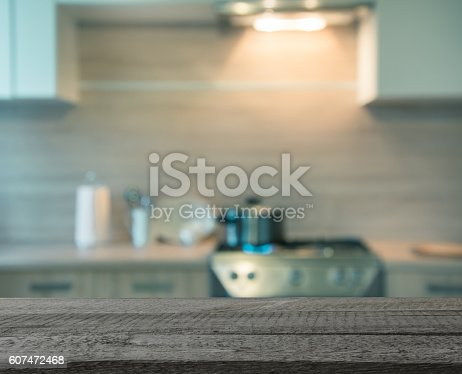 607472174istockphoto Blurred background. Modern kitchen with cooking on gas. Toned image. 607472468