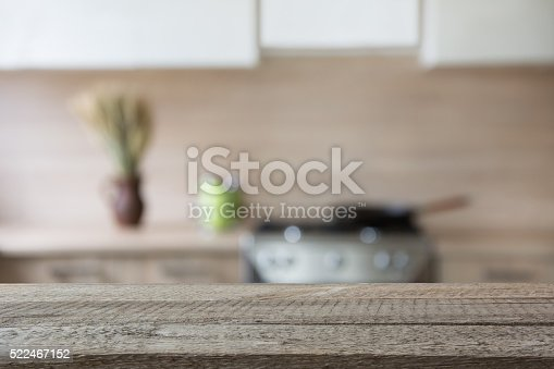istock Blurred background. Modern kitchen with tabletop and space for you. 522467152