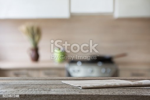 607472268istockphoto Blurred background. Modern kitchen with tabletop and space for you. 522467248