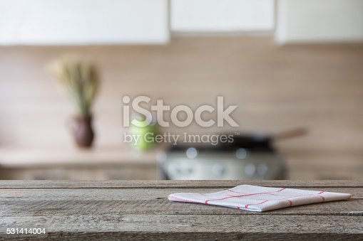 607472174istockphoto Blurred background. Modern kitchen with tabletop and space for you. 531414004