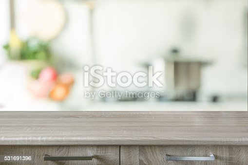 istock Blurred background. Modern kitchen with tabletop and space for you. 531691396