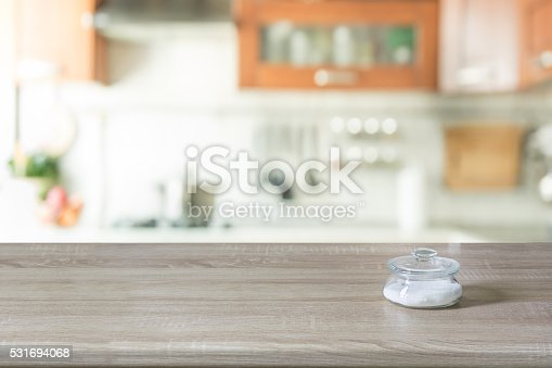 607472174istockphoto Blurred background. Modern kitchen with tabletop and space for you. 531694068