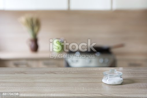 607472268istockphoto Blurred background. Modern kitchen with tabletop and space for you. 531704238