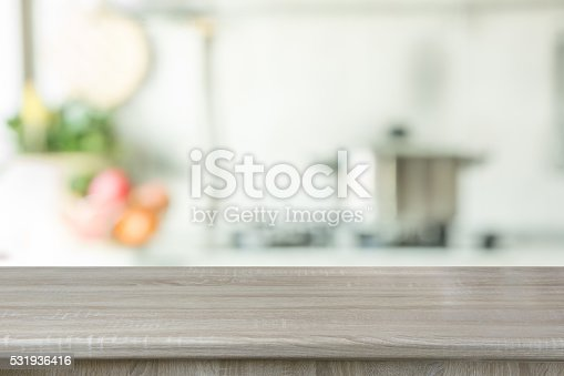607472268istockphoto Blurred background. Modern kitchen with tabletop and space for you. 531936416