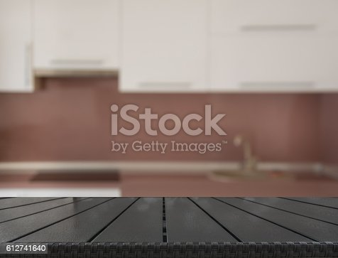 607472268 istock photo Blurred background. Modern kitchen with tabletop and space for you. 612741640