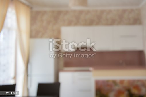607472268 istock photo Blurred background. Modern kitchen with tabletop and space for you. 612860696