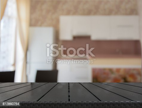 607472174istockphoto Blurred background. Modern kitchen with tabletop and space for you. 612860754