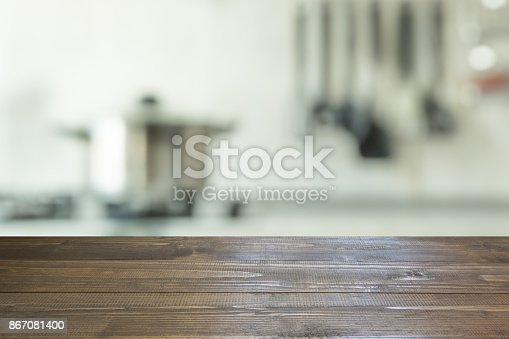 607472268 istock photo Blurred background. Modern kitchen with tabletop and space for you. 867081400